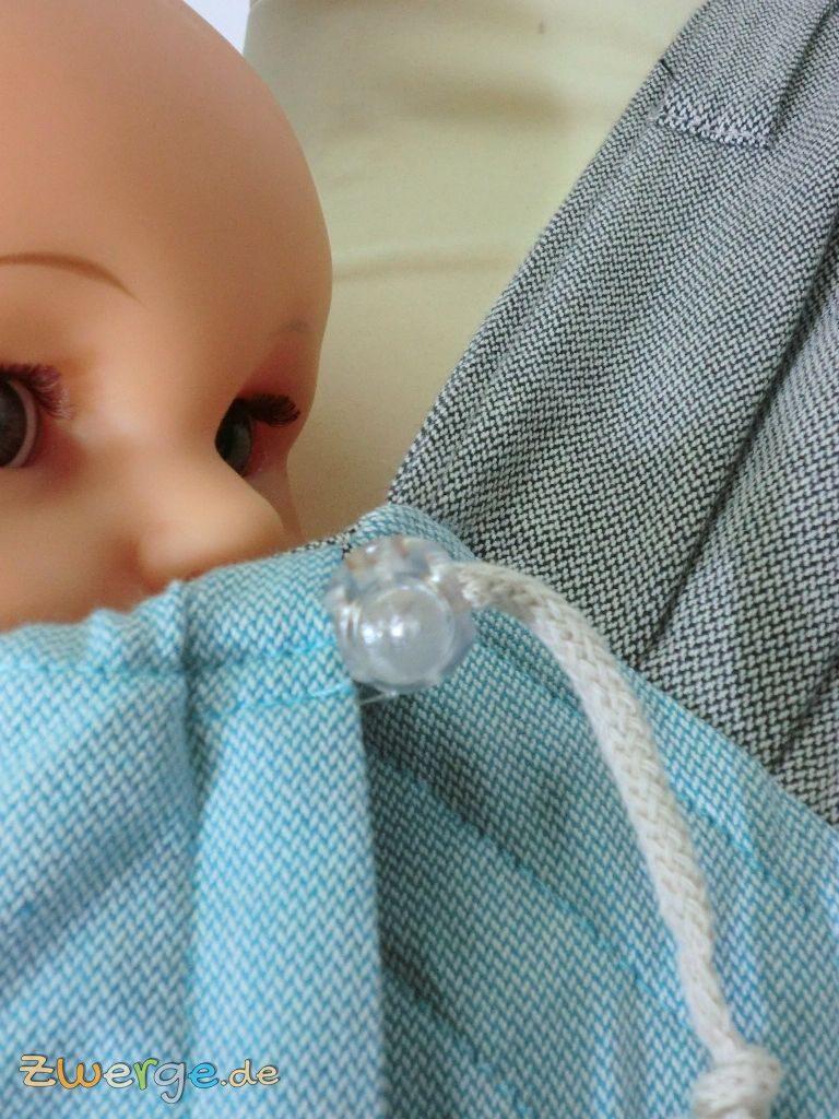 Limas Babytrage - Zugband im Nackenbereich